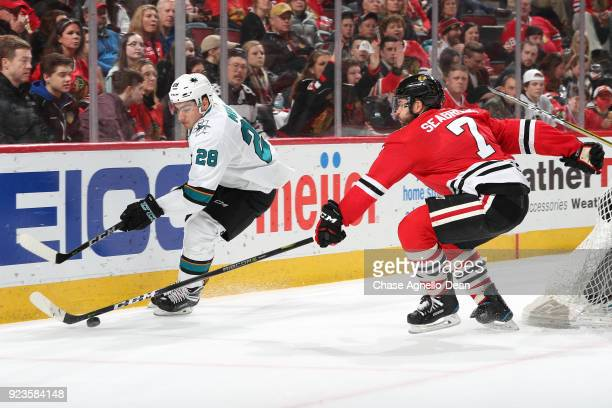 Timo Meier of the San Jose Sharks and Brent Seabrook of the Chicago Blackhawks chase the puck in the third period at the United Center on February 23...