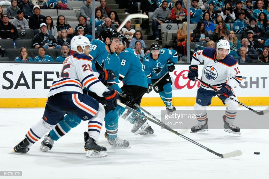 Timo Meier #28 of the San Jose Sharks and Darnell Nurse #25 of the Edmonton Oilers chase the puck at SAP Center on February 10, 2018 in San Jose, California.