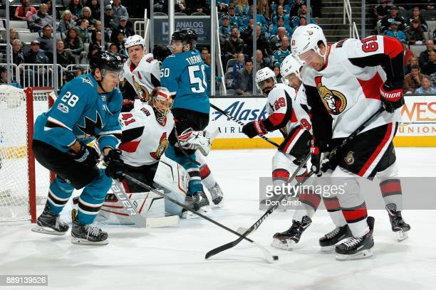 Timo Meier of the San Jose Sharks and Mark Stone of the Ottawa Senators battle for the puck at SAP Center on December 9 2017 in San Jose California
