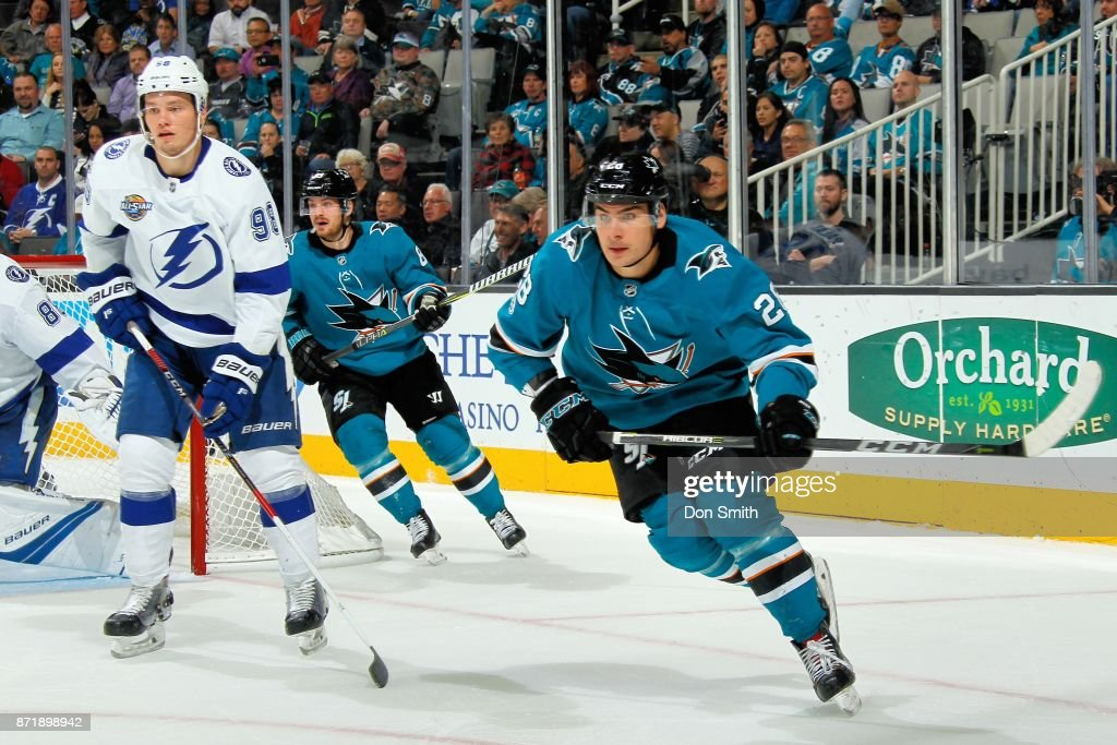 Timo Meier #28 of the San Jose Sharks and Mikhail Sergachev #98 of the Tampa Bay Lightning watch the puck at SAP Center on November 8, 2017 in San Jose, California.