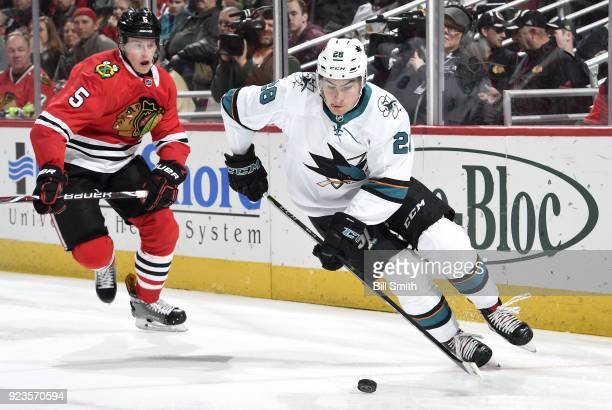 Timo Meier of the San Jose Sharks approaches the puck ahead of Connor Murphy of the Chicago Blackhawks in the second period at the United Center on...