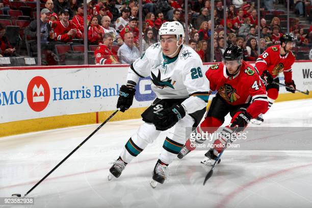 Timo Meier of the San Jose Sharks approaches the puck ahead of Jan Rutta of the Chicago Blackhawks in the third period at the United Center on...