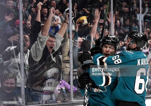 Timo Meier of the San Jose Sharks celebrates his goal with Melker Karlsson against the New York Rangers at SAP Center on October 30 2018 in San Jose...