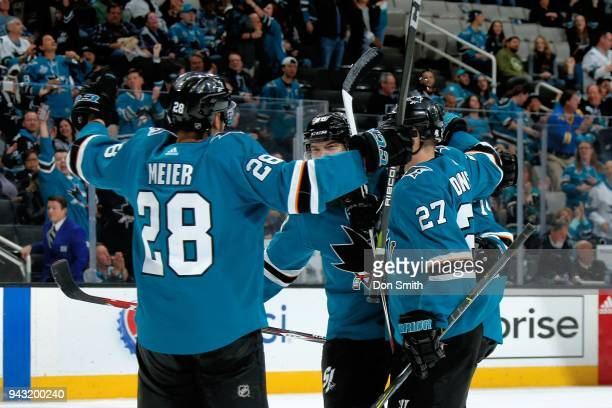 Timo Meier of the San Jose Sharks celebrates his third period goal against the Minnesota Wild with teammates at SAP Center on April 7 2018 in San...