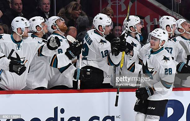 Timo Meier of the San Jose Sharks celebrates with the bench after scoring a goal against the Montreal Canadiens in the NHL game at the Bell Centre on...