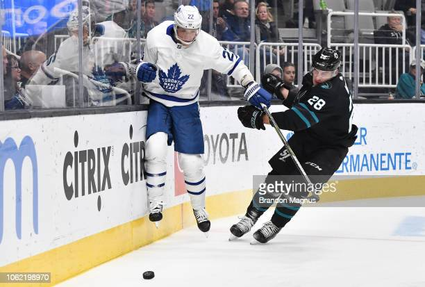 Timo Meier of the San Jose Sharks chases the puck with Nikita Zaitsev of the Toronto Maple Leafs at SAP Center on November 15 2018 in San Jose...
