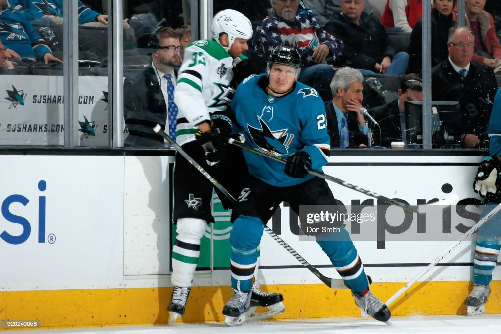Timo Meier #28 of the San Jose Sharks checks Marc Methot #33 of the Dallas Stars against the boards at SAP Center on February 18, 2018 in San Jose, California.