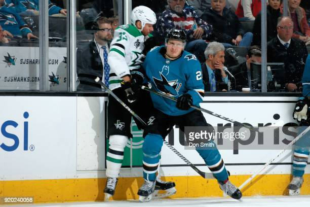 Timo Meier of the San Jose Sharks checks Marc Methot of the Dallas Stars against the boards at SAP Center on February 18 2018 in San Jose California