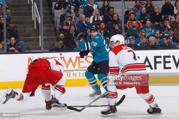 Timo Meier of the San Jose Sharks clears the puck against the Carolina Hurricanes at SAP Center on December 7 2017 in San Jose California