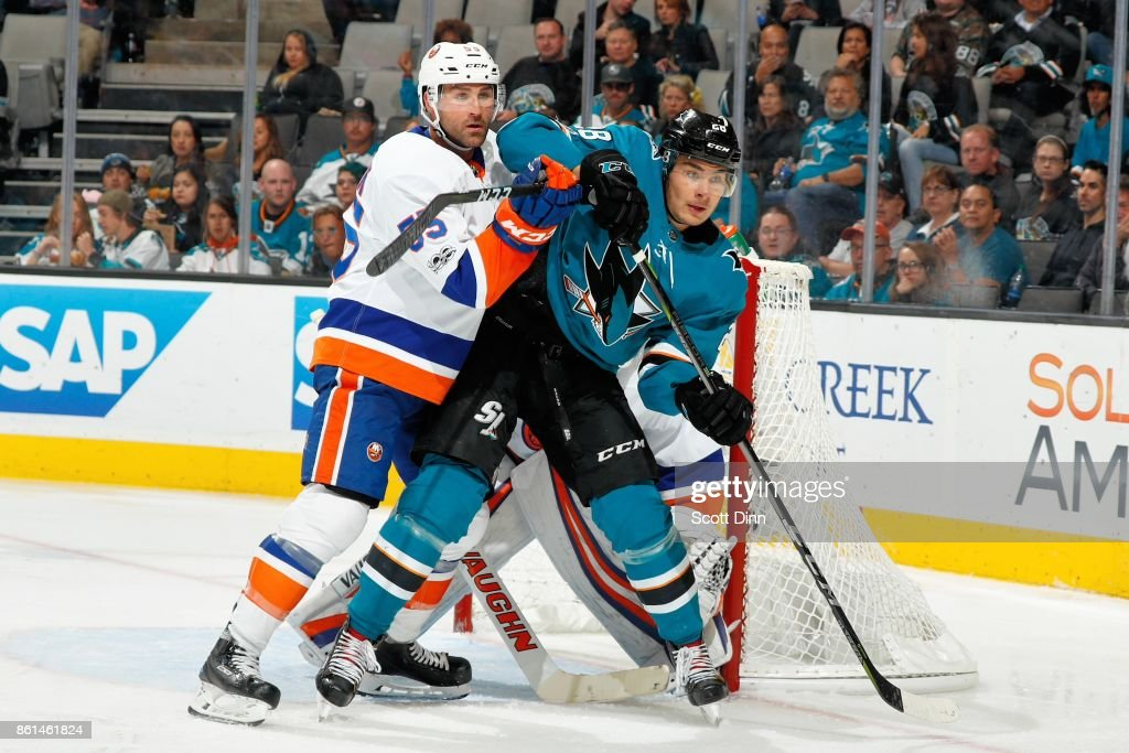 Timo Meier #28 of the San Jose Sharks is defended by Johnny Boychuk #55 of the New York Islanders at SAP Center on October 14, 2017 in San Jose, California.