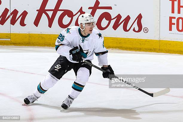 Timo Meier of the San Jose Sharks keeps an eye on the play down the ice during third period action against the Winnipeg Jets at the MTS Centre on...