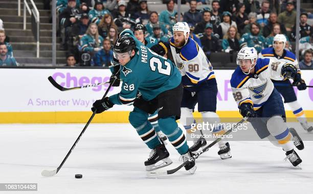 Timo Meier of the San Jose Sharks skates ahead of Ryan O'Reilly and Vince Dunn of the St Louis Blues at SAP Center on November 17 2018 in San Jose...