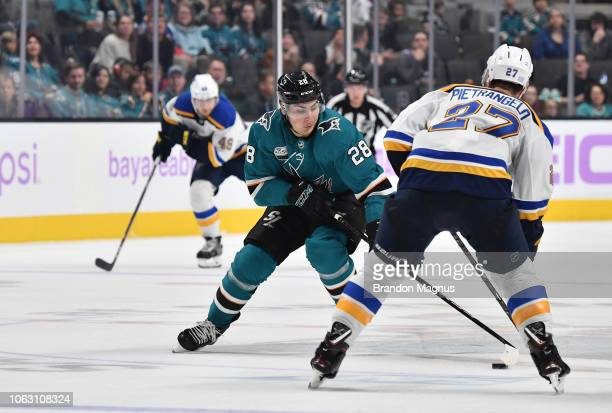 Timo Meier of the San Jose Sharks skates with the puck against Alex Pietrangelo of the St Louis Blues at SAP Center on November 17, 2018 in San Jose,...