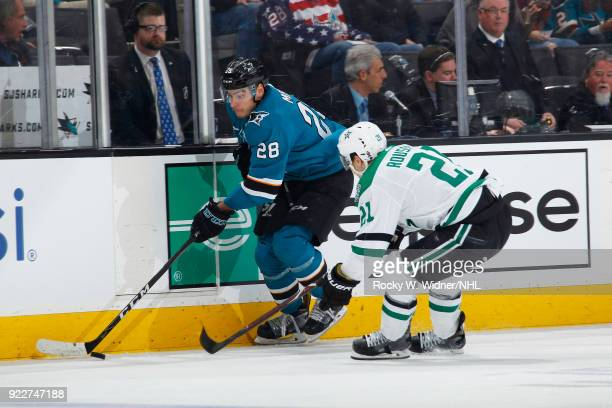 Timo Meier of the San Jose Sharks skates with the puck against Antoine Roussel of the Dallas Stars at SAP Center on February 18 2018 in San Jose...