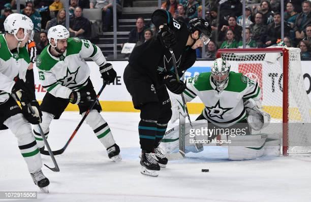 Timo Meier of the San Jose Sharks turns to take a shot on goal against Anton Khudobin of the Dallas Stars at SAP Center on December 13 2018 in San...