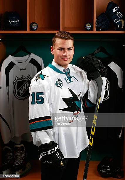 Timo Meier poses for a portrait after being selected ninth overall by the San Jose Sharks during Round One of the 2015 NHL Draft at BBT Center on...