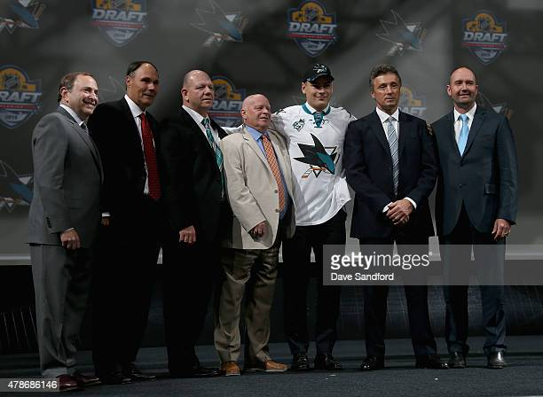 Timo Meier poses on stage with NHL commissioner and team personnel after being selected ninth overall by the San Jose Sharks during Round One of the...