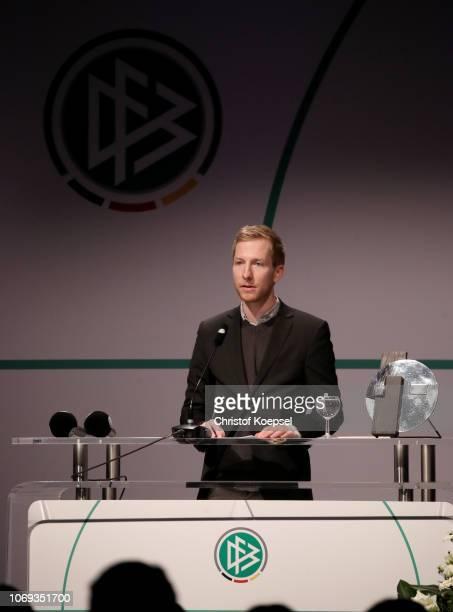 Timo Milcarek reads the vita of Julius Hirsch during the JuliusHirschPreis Awarding Ceremony at Deutsches Fussballmuseum on November 18 2018 in...