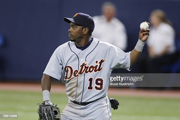 Timo Perez of the Detroit Tigers throws in a game against the Minnesota Twins at the Humphrey Metrodome in Minneapolis, Minnesota on September 16,...