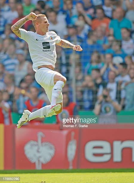 Timo Perthel of Braunschweig celebrates scoring his teams first goal during the DFB Cup first round match between Arminia Bielefeld and Eintracht...