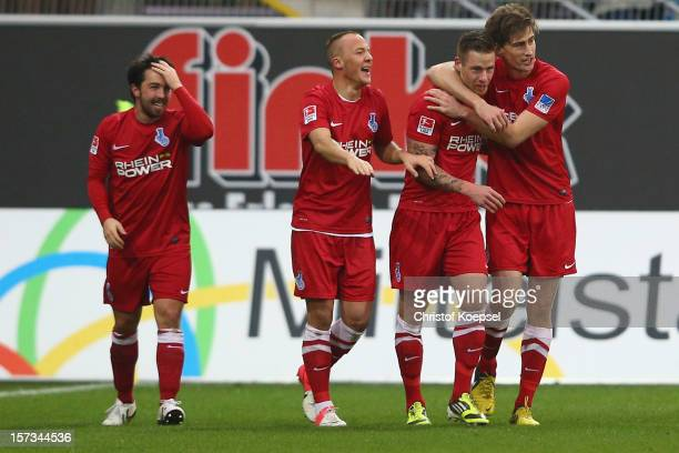 Timo Perthel of Duisburg celebrates the second goal with Benjamin Kern Maurice Exslager and Dustin Bomheuer during the Second Bundesliga match...