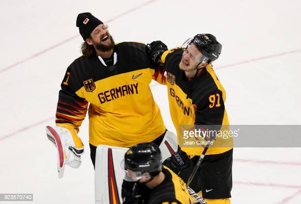 Timo Pielmeier and Moritz Muller of Germany celebrate after victory in Men's Semifinal ice hockey match between Canada and Germany on day fourteen of...