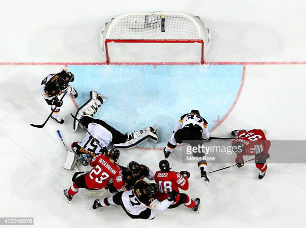 Timo Pielmeier goaltender of Germany makes a save during the IIHF World Championship group A match between Switzerland and Germany at o2 Arena on May...