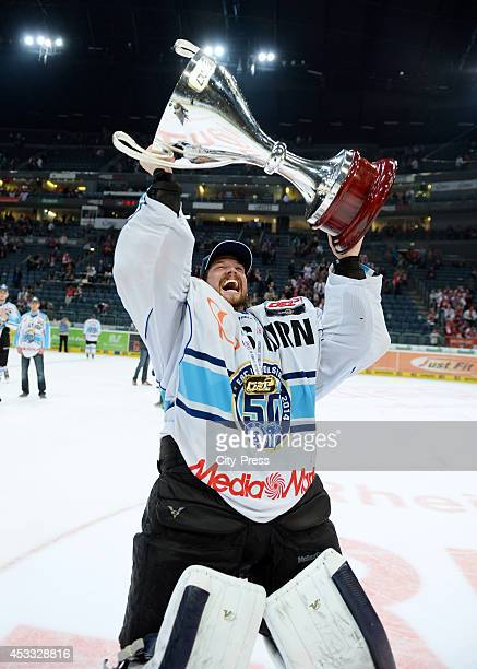 Timo Pielmeier holds the trophy after game seven of the DEL playoff final on April 29, 2014 in Cologne, Germany.