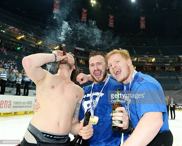 Timo Pielmeier , Travis Turnbull und Christoph Gawlik celebrate the championship after game seven of the DEL playoff final on April 29, 2014 in...