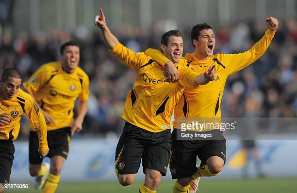 Timo Roettger of Dynamo Dresden celebrates with team mate Aleksandro Petrovic after scoring his team's first goal during the 3 Liga match between...