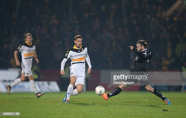 Timo Roettger of Grossaspach challenges Justin Eilers of Dresden during the dritte LIga match between SG Sonnenhof Grossaspach vs Dynamo Dresden on...