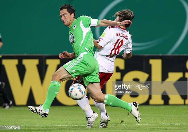 Timo Roettger of Leipzig and Marcel Schaefer of Wolfsburg battle for the ball during the DFB Cup first round match between RB Leipzig and VfL...
