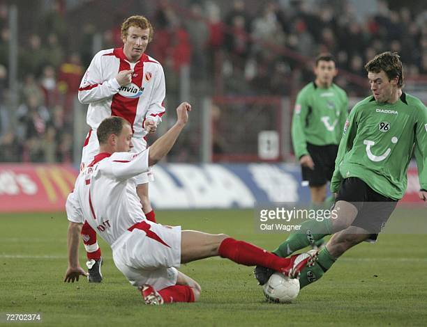 Timo Rost of Cottbus battles for the ball with Hanno Balitsch of Hannover during the Bundesliga match between Energie Cottbus and Hanover 96 at the...