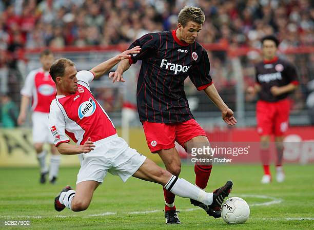 Timo Rost of Cottbus in action against Alexander Meier of Frankfurt during the match of the Second Bundesliga between Energie Cottbus and Eintracht...