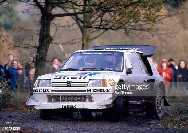 Timo Salonen and Seppo Harjanne of Finland the eventual winners driving a Peugeot 205 Turbo 16 during the Lombard RAC Rally circa 1986