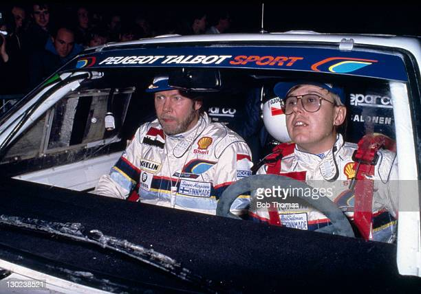 Timo Salonen and Seppo Harjanne of Finland the eventual winners driving a Peugeot 205 Turbo during the Lombard RAC Rally circa 1986