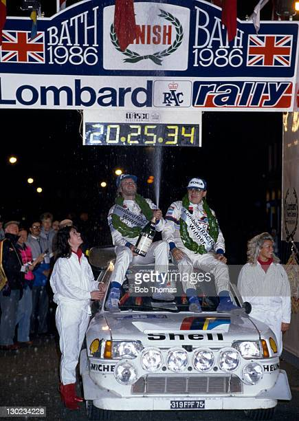 Timo Salonen and Seppo Tarjanne of Finland celebrate their victory in the Lombard RAC Rally atop their Peugeot 205 Turbo 16 in Bath circa 1986