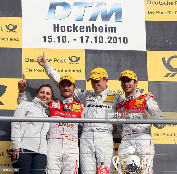 Timo Scheider of Germany and Audi Sport Team Abt finishing 2nd position Paul Di Resta of Scotland and AMG Mercedes finishing 1st position and Mike...