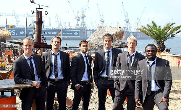 Timo Schultz goalkeeper Mathias Hain Fabio Morena Thomas Kessler Marius Ebbers and Gerald Asamoah pose during the FC St Pauli street wear...