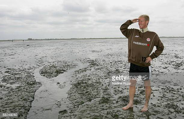 Timo Schultz in action during a walk through the wadden sea during the FC StPauli training camp session for the 20052006 season on July 17 2005 in...