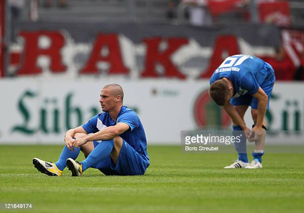 Timo Staffeldt and Thorben Stadler of Karlsruhe show their frustration after loosing the Second Bundesliga match between FC Energie Cottbus and...