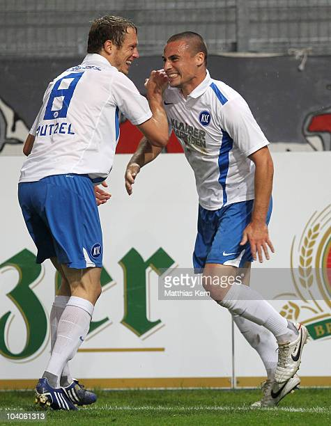 Timo Staffeldt of Karlsruhe jubilates with team mate Michael Mutzel after scoring the seventh goal during the Second Bundesliga match between FC...