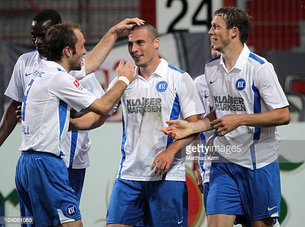 Timo Staffeldt of Karlsruhe jubilates with team mates after scoring the seventh goal during the Second Bundesliga match between FC Energie Cottbus...