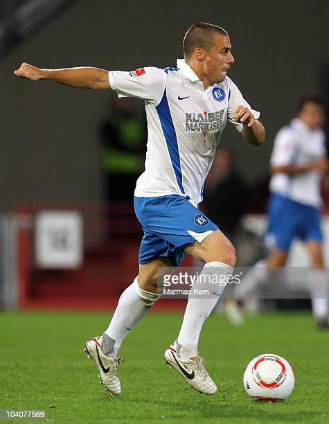 Timo Staffeldt of Karlsruhe runs with the ball during the Second Bundesliga match between FC Energie Cottbus and Karlsruher SC at Stadion der...