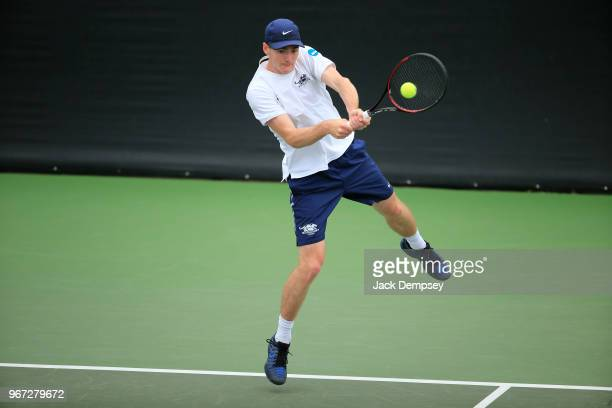 Timo van de Geest of the Middlebury Panthers hits a backhand against the Bowdoin Polar Bears during the Division III Men's Tennis Championship held...
