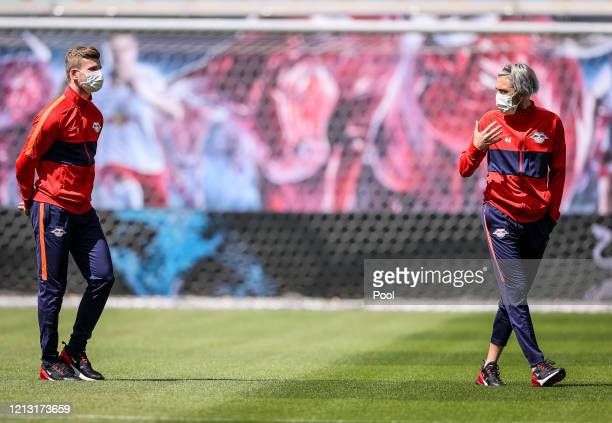 Timo Werner and Kevin Kampl of RB Leipzig wear protectice face masks as they inspect the pitch prior to the Bundesliga match between RB Leipzig and...