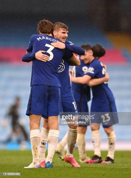 Timo Werner and Marcos Alonso of Chelsea celebrate their side's victory after the Premier League match between Manchester City and Chelsea at Etihad...