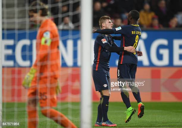 Timo Werner and Naby Deco Keita of RB Leipzig celebrate their side's first goal during the Bundesliga match between FC Augsburg and RB Leipzig at WWK...