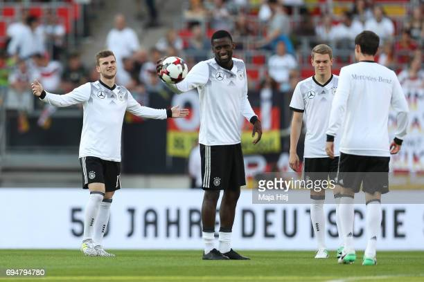 Timo Werner Antonio Ruediger Matthias Ginter and Sebastian Rudy of Germany warm up prior to the FIFA 2018 World Cup Qualifier between Germany and San...