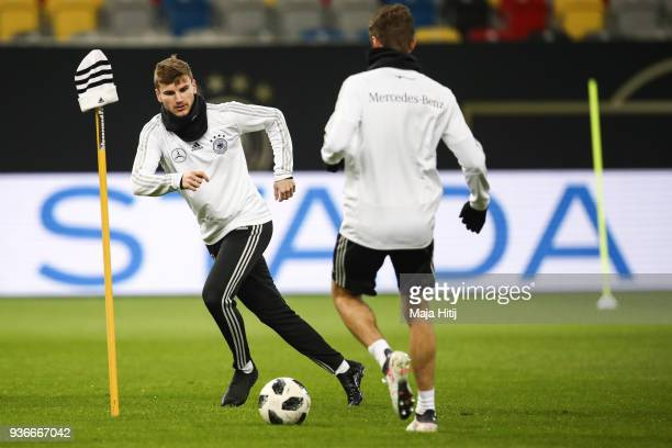 Timo Werner controls the ball during a Germany training session ahead of their international friendly match against Spain at ESPRIT arena on March 22...